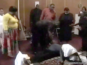 In the video, Manifested Glory Ministries members gather around a boy in Bridgeport, Connecticut.
