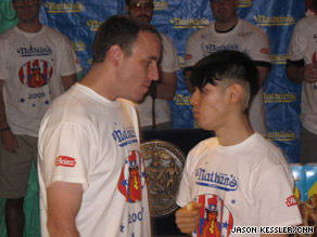 "Competitive eaters Joey Chestnut and Takeru Kobayashi take part in an official ""staredown."""