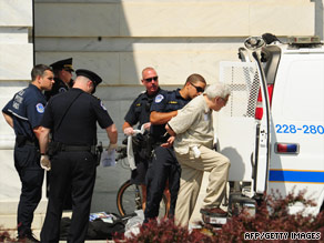 A man is placed in a van Thursday after being arrested on suspicion of unlawfully demonstrating in the Capitol.