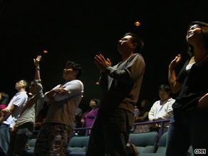 Worshippers sing at Joy Christian Fellowship, which meets at Edgewater Multiplex Cinemas in New Jersey.