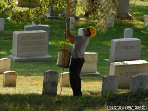 Crews headed into the trees at the cemetery Monday to help protect them from lightning.