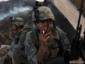 Defense Secretary Robert Gates says he does not want to compound stress in combat zones by banning smoking.