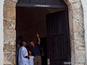 Obama points to the Door of No Return, which would shut before Africans were put on slave ships.
