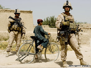 U.S. Marines partrol part of the Gharmsir district in Afghanistan's Helmand province on Wednesday.