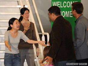 Freed journalists Euna Lee and Laura Ling after being released from North Korea on August 5, 2009.