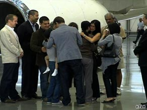 The journalists share an emotional reunion with their families Wednesday at the Bob Hope Airport in Burbank.