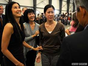 Freed journalist Euna Lee is followed by Laura Ling off their plane Wednesday in California.