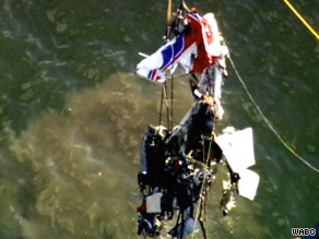 The wreckage of a PA-32 that collided Saturday with a helicopter is lifted Tuesday from the bed of the Hudson River.