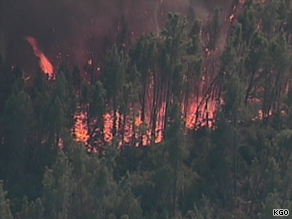 Brush and trees are consumed by flames early Thursday in northern California.