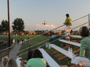 Spectators at a high school football scrimmage watch as a plane goes down Friday in Ohio.