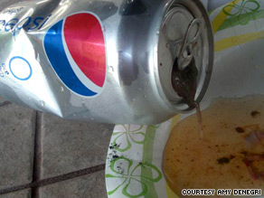 Amy DeNegri took pictures of the can in question right after her husband gagged on its contents.