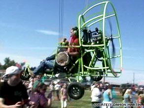 Spectators scatter as a motorized parachute plummets Monday in Hooper, Utah.