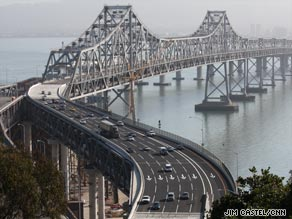 Commuters make the trek across the San Francisco-Oakland Bay Bridge after it reopened Tuesday.
