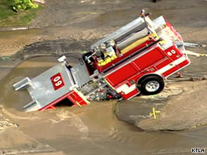 It took workers several hours to get the firetruck out of the sinkhole.