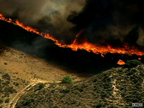 Strong wind, grass and light brush are fueling the Guiberson fire in southwest California.