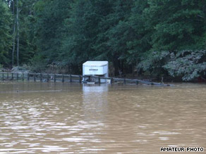 Floodwaters hit the ranch of Ed and Nancy Wellham on Monday. At least three horses died there.