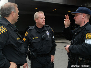Police officers from Tucson, Arizona, left, talk with a Pittsburgh officer Thursday outside the G-20 summit.