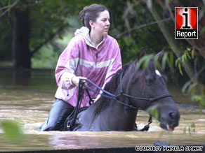 One iReporter captured the rescue of a group of horses that were up to their noses in water.