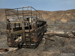 The Sheep Fire in Southern California has burned thousands of acres and left this bus a charred ruin.
