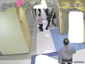 Videotape allegedly shows an unidentified police officer assaulting student Marshawn Pitts, 15.