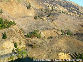 The landslide covered up to a half-mile of Washington state Route 410 with rock up to 30 feet deep.
