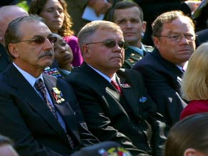Veterans watch Tuesday's ceremony, which recognized members of a U.S. cavalry unit.