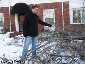 John Randolph moves fallen branches at his home in the Louisville, Kentucky, area Sunday.