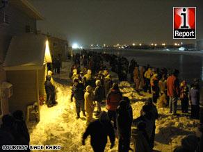 Volunteers wait early Thursday for sandbags in Fargo, North Dakota, in a photo from iReporter Wade Baird.