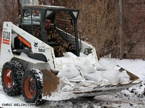 Explosives are set off Wednesday evening in the Missouri River to break up ice jams.