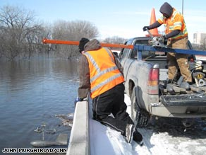 Valley Water Rescue volunteers patrol the Fargo area in search of people who need help evacuating Friday.