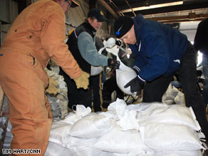 Volunteers at a Fargo, North Dakota, city facility continue to fill and stack sandbags Friday.