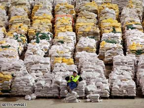 A trucker relaxes April 1 on sandbag pallets in Fargo, North Dakota,  which is preparing for more flooding.