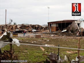 """It looks like a war zone out here,"" said James Reeves of emergency management in Polk County, Arkansas."