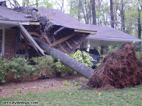 John Kiefer was sitting on his couch moments before a tree fell into his living room.