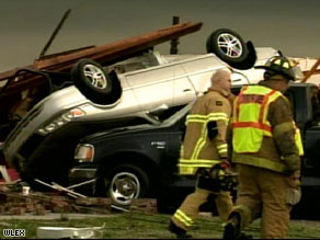 Strong winds tossed one car on top of another Friday in Kirkville, Kentucky.
