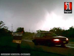 iReporter Michael Ambrosia captures a twister Wednesday near Novinger, Missouri.