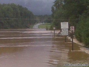 Floodwaters cover a road in Powder Springs, Georgia, on Monday.