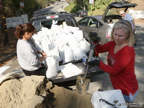 Residents of La Canada Flintridge, California, fill sandbags to prepare heavy rains in the fire-affected area.