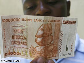 A boy examines the new $50 billion dollar note issued by Zimbabwe's central bank on January 13, 2009.