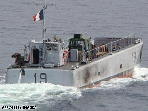 A French ship with investigators on board look for clues near the crash site area.