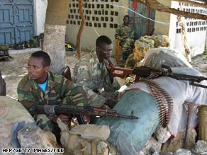 Islamist fighters relax on January 12 at a base in Somalia formerly occupied by Ethiopian soldiers.