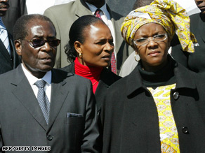 Judge says Grace Mugabe, pictured with her husband, effectively took his farm by force.