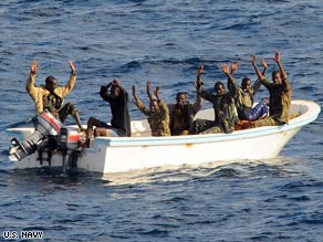Seven men suspected of trying to pirate a tanker raise their hands before their arrest in the Gulf of Aden.