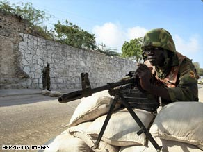 An African Union peacekeeper stands guard at the presidential palace in Mogadishu.