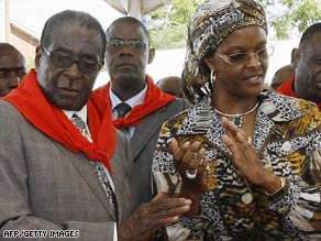 President Robert Mugabe and his wife, Grace, attend a cake-cutting ceremony for his birthday Saturday.