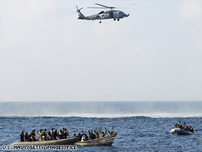 The U.S. Navy apprehends suspected pirates February 12 in the Gulf of Arden.