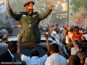 Sudan's President Omar Hassan al-Bashir waves to supporters in Khartoum on Wednesday.