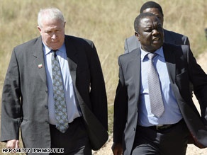 Opposition politician Roy Bennett, left, confers with leader Morgan Tsvangirai last year in South Africa.