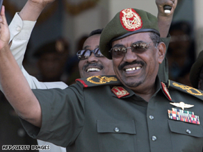 Sudanese President Omar Hassan al-Bashir waves to troops at a rally in Khartoum, Sudan, on Tuesday.