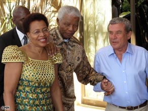 Nelson Mandela, accompanied by his wife Gracia Marcel, are greeted by Sol Kerzner.